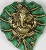 Green & Gold Metal Ganesh Idol on Leaf Base Wall Hanging by Aapno Rajasthan