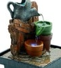 Multicolour Polyresin Log & Watering Can Led Water Fountain by Importwala