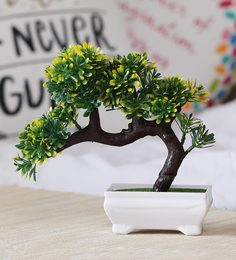 Multicolour Plastic Artificial Plant Bent With Green And Yellow Leaves