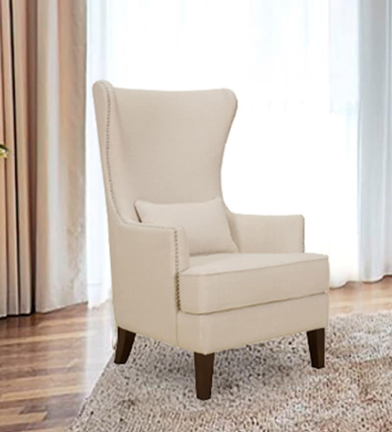 Wing Chair with Nailhead Trim in Beige Colour by Dreamzz Furniture